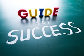 Guide for success concept, words on blackboard